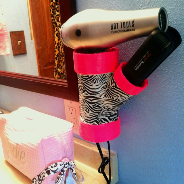 """3"""" by 2"""" PVC pipe and duct tape to keep hair dryer and straightener handy!  Great big sis, little sis gift during cheer camp."""