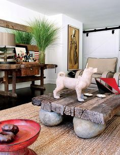 Coffee table from old Balinese railroad ties on stones; console is old Hungarian workbench; Antonio Martins