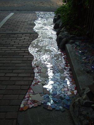 humm never thought of mirror mosaic in garden paths--- ooohh. pretty mosaic path with mirrory sparkles.