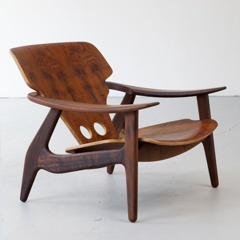 "R 20th Century Sergio Rodrigues, Brazil, 2012 ""Diz"" chair with holes with an oil finish in imbula."