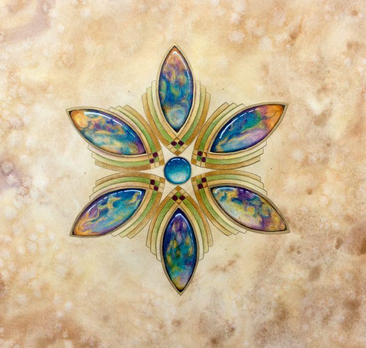 Mandala Titel : Peacock color. Gemstones gemaakt naar de kleuren van de pauwenerts. Gemaakt door Els van der Lugt 20-6-2017 n.a.v. De Youtupe les van Kim Vermeer 15-06-2017 Materiaal: achtergond is gemaakt met aquarelverf op mandalapapier. Gekleurd met potlood.