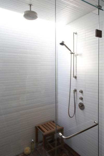 More Heath tiles here. What about one rain shower and one wall mount? Lots more cost? Could be worth it in the long run.