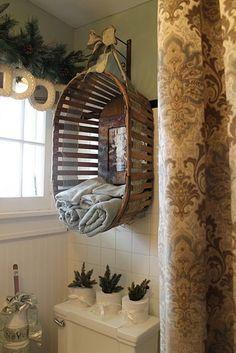 Basket hung as unique bathroom towel storage.