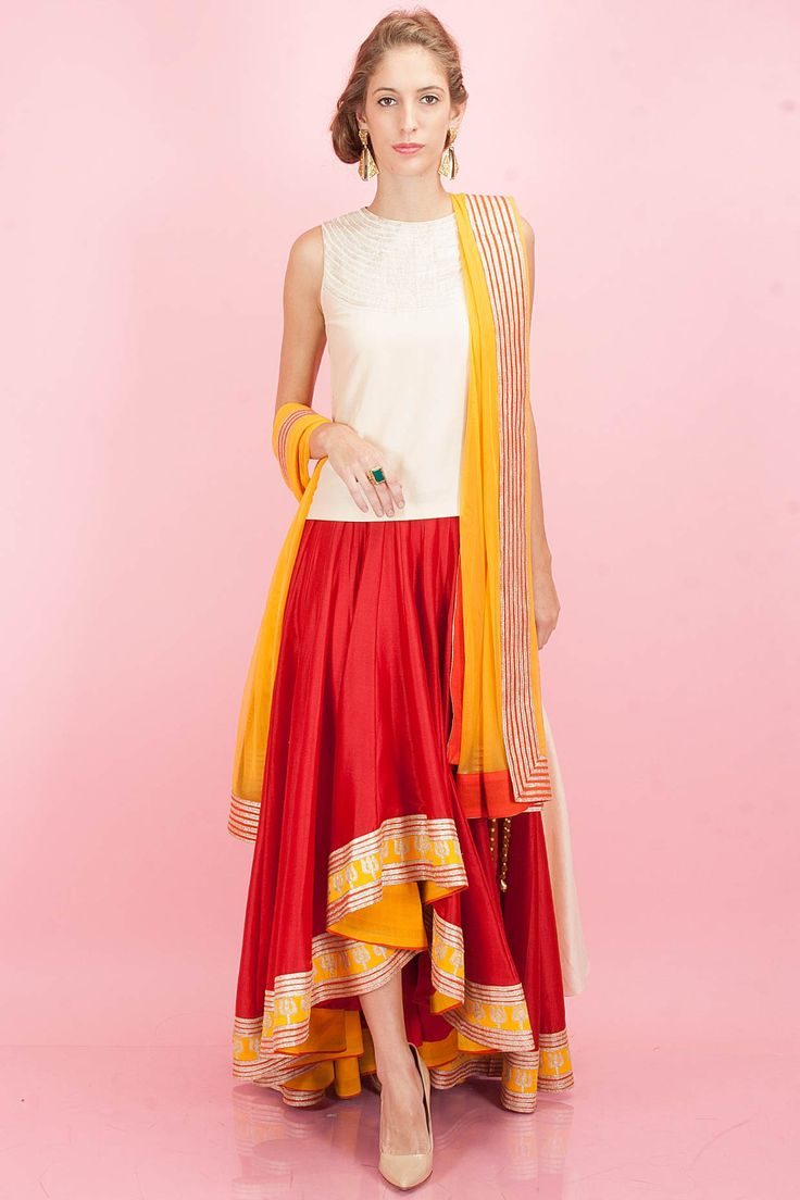 Beige high low blouse with red high low lehenga available only at Pernia's Pop-Up Shop.