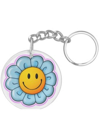 "Never leave home without your Smiley Riley Sunflower keychain - attached to your bag, pencil case or keys. Designed to withstand daily wear and tear, this keychain has vibrant clarity and brilliant colors. The keychain is 2"" in diameter, UV resistant and waterproof - with the Smiley Riley Sunflower on both sides. A great gift. Suggested age range 5-12 years."