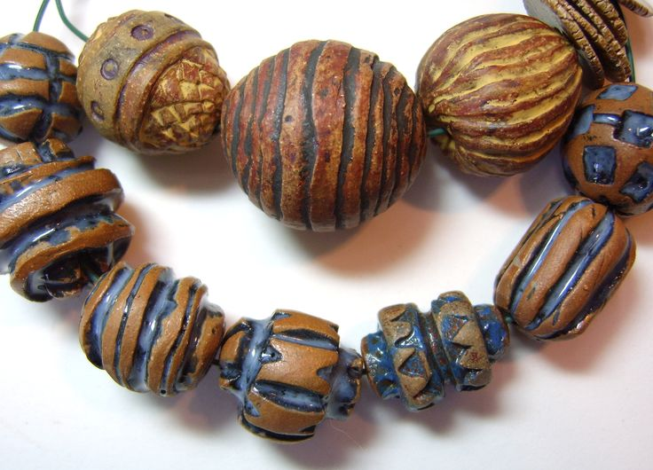 ABS August Monthly challenge gas fired stoneware beads finished with terra sigillata by BHClaysmith.