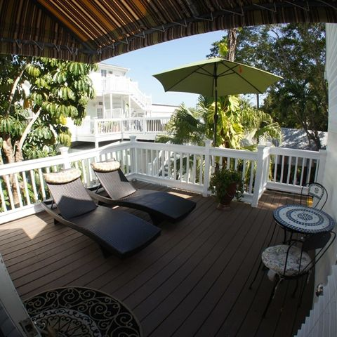 Seascape Inn B&B, between Duval and the lighthouse.  Love the Deluxe King with Patio.  Free breakfast.  Approx. $1,700/6 nights