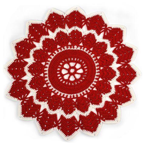 Vi älskar dukar –särskilt röda dukar till jul! Därför innehåller lucka 20ännu en design ur vårt gamla arkiv: En vacker stjärnduk, som kan virkasså liten eller stor du vill. Stjärnduk...