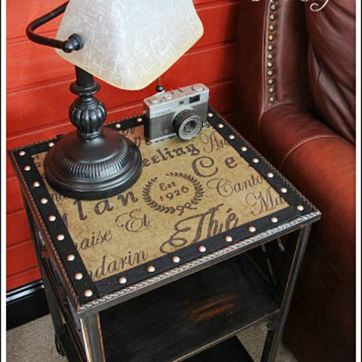Dark brown end table with decoupaged beige and brown word paper on center insert, and NAILHEAD TRIM.