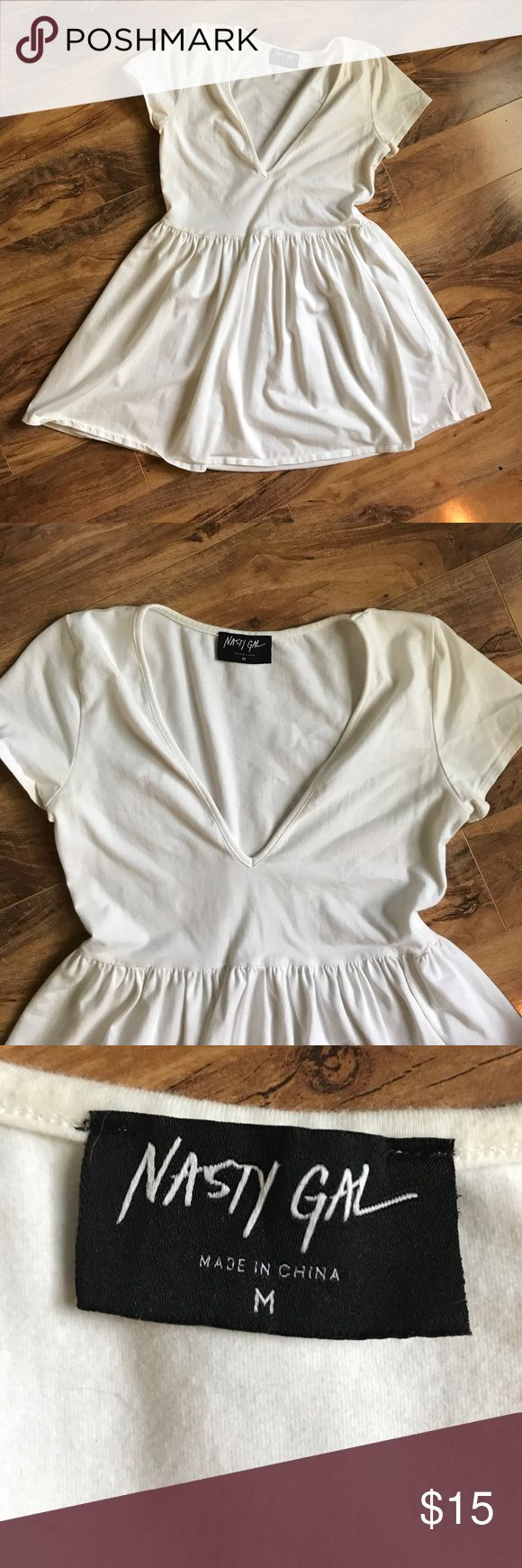 Nasty Gal Baby Doll T Gently used Nast Gal baby doll T shirt/dress. Deep v neckline with wide gathered waist. Nasty Gal Dresses Mini