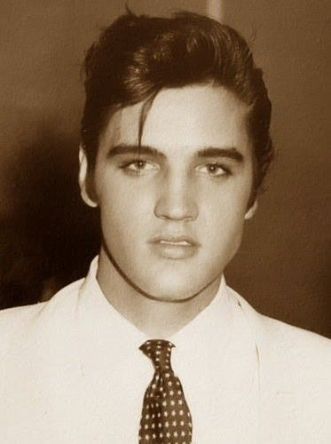 Elvis Presley - Tupelo, Miss. You can see those sexy features coming through even then when he was just a young man.