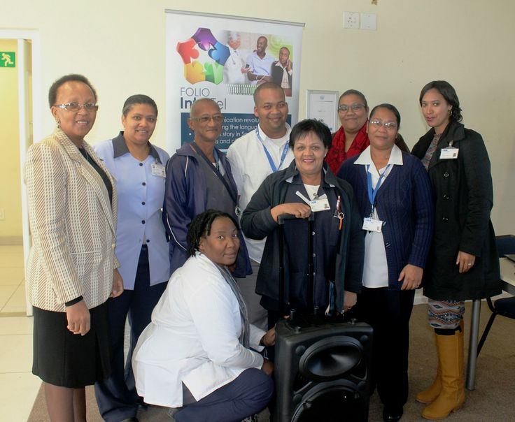 Staff members of Mitchells Plain CHC, two-time winner of Folio InterTel's monthly competition, with their prize, a portable PA system with cordless microphones.