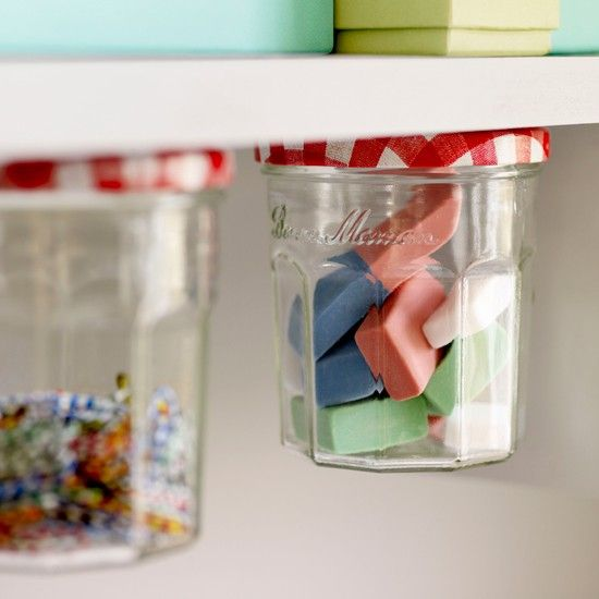 Save your jelly jars, clean them out, and use them to store items like paper clips, erasers, safety pins, mini post its, etc.