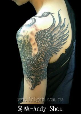griffin tattoo on the arm
