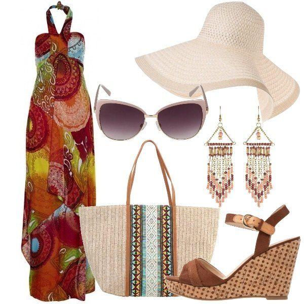 Outfit composto da abito lungo fantasia in jersey, borsa a mano in materiale intrecciato e sandali con zeppa. Completano il look gli orecchini pendenti, gli occhiali da sole con montatura a farfalla ed il cappello a falda larga.