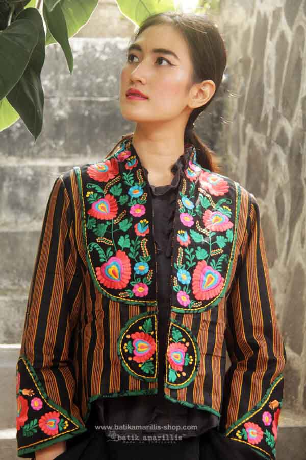 Batik Amarillis made in Indonesia proudly presents :Batik Amarillis's Arcana embroidery jacket #3 in gorgeous Lurik Surjan of Jogjakarta-Indonesia ....Stand out in the crowd with this unique and stunning jacket!this contemporary & yet vintage style is accented with exquisite full Hungarian embroidery also features 4 triangle arcana tassels to complete the whole extravangant work of art!.