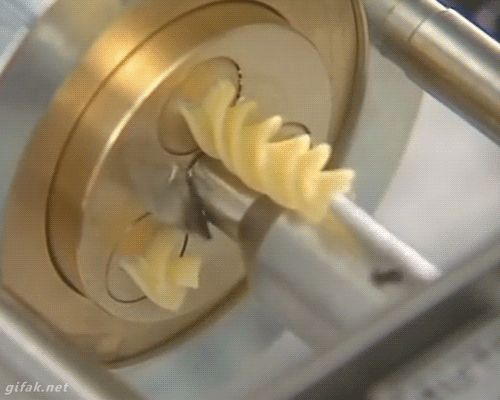 A Pasta Machine Slicing Rotini in a Hypnotic Never-Ending Loop