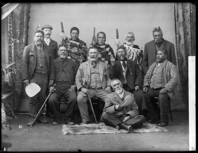 Portrait of nine Maori men, including Waata Hipango and Takarangi Metekingi, and two Europeans - Photograph taken by William Henry Thomas Partington