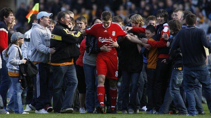 Liverpool captain Steven Gerrard swarmed by fans. Picture taken by Craig Brough, Action Images.