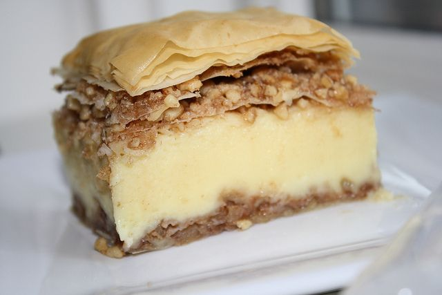 Bougatsa..a lesser known cousin of baklava..with a rich and creamy custard in a blanket of crispy and buttery filo and two layers of sweet and crunchy walnuts and cinnamon