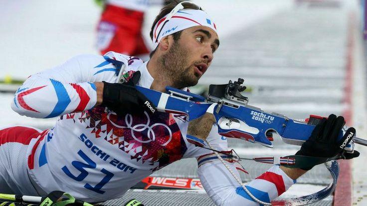 France's Martin Fourcade prepares to shoot.