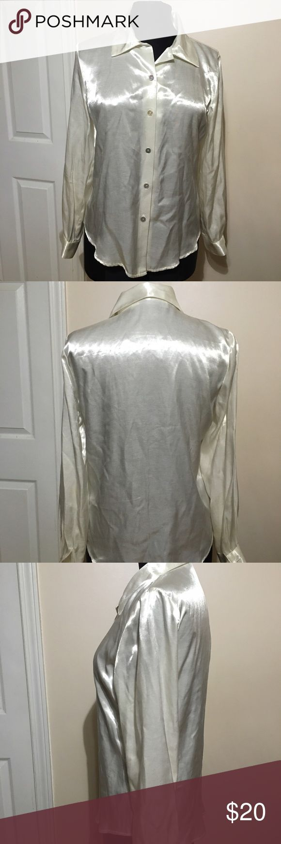 White shines satin blouse Beautiful bright white satin blouse with mother pearl type buttons great for all these holiday parties size small Tops Button Down Shirts