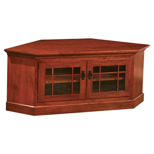 This Mission Corner TV Stand with Two Doors is made by highly skilled craftsman that expresses their appreciation of making hand made furniture. It is made out of solid Cherry wood that is been hand selected. In addition, the wood exhibits a unique grain pattern of a cherry wood.   It features a glass Mullion doors and black Mission Style handles that is typical characteristics of the Arts & Crafts style. The shelf will accommodate your DVD/Cable equipment or other electronic devices. This…