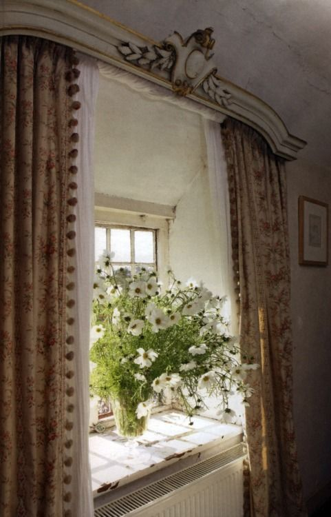 Curtains & tumbling white Cosmos.  thefrenchinspiredroom.com