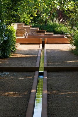 Linear fountain at Jardin de la Noria - Mas de Licon - St. Quentin la Poterie in France designed by Arnaud Maurieres and Eric Ossart | photograph by Clive Nichols.
