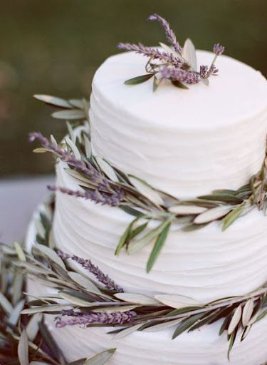 Wedding cake decorated with lavender and olive leaves