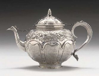 AN EARLY 18TH CENTURY DUTCH SILVER TEAPOT, 1728. With beaded rat-tail to scroll handle which terminates in an escutcheon, the sides with matted, lobed panels below a band of scrolling flowers & acorns, the spout with faceted lower section, tucked-in foot with fluted edge, the lobed, domed cover secured to tops of spout & handle by means of a chain which attaches below the pine cone finial