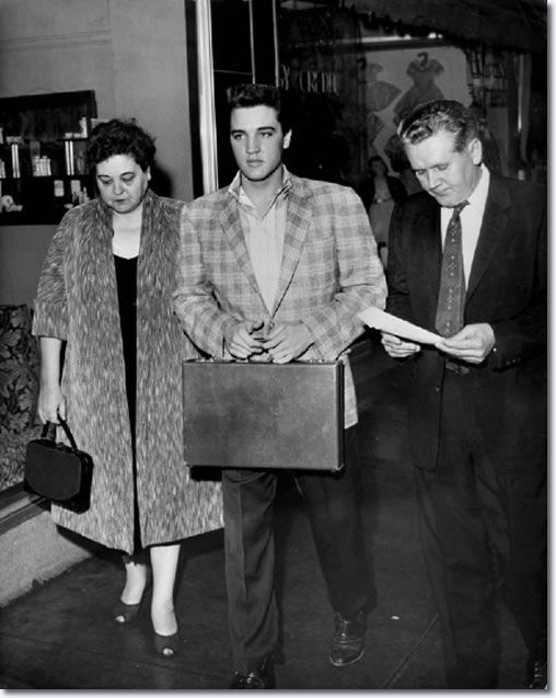 Elvis with his parents (draft board)