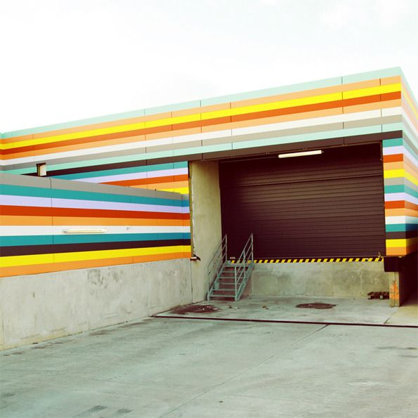 Photographer Matthias Heiderich takes pictures of colourful candy-striped warehouses