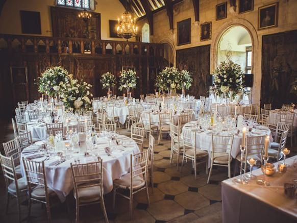 The opulent interiors at Berkeley Castle provide a wonderful backdrop for the #wedding breakfast. #weddingtables #weddingvenue #castlewedding #cotswoldwedding