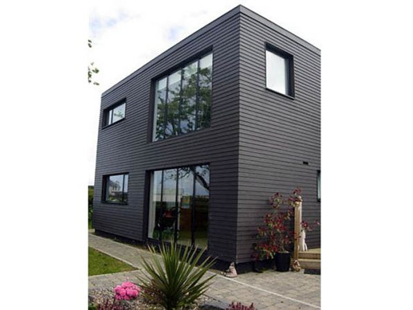 black windows, black weatherboard, no architraves.