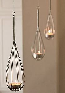 Find some cheap wire whisks for this low-cost kitchen decoration.
