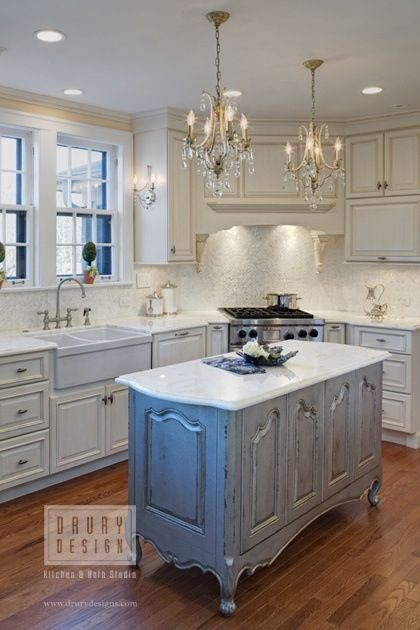 Using a buffet or sideboard topped with marble as an island.