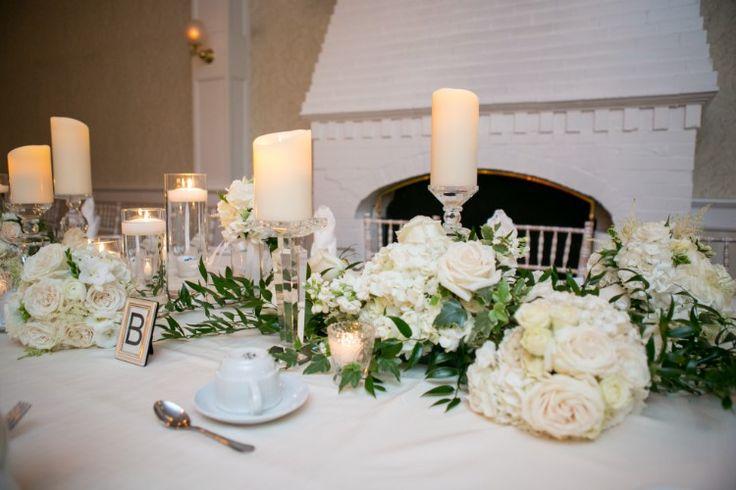 Elegant monochrome wedding reception with candles and flowers (Kristina Lynn Photography & Design)
