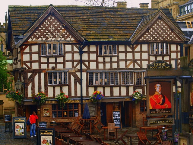 The Old  Wellington Inn....Manchester UK    The building known as the Wellington Inn has existed since 1552 when  Edward VI was on the throne. At that time it was situated in the  Market Place and Shambles. It is now the oldest building in  Manchester.