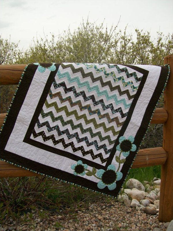 http://www.cutequiltpatterns.com/shop/Girl-Baby-Quilt-Patterns/p/Pick-Me.htm