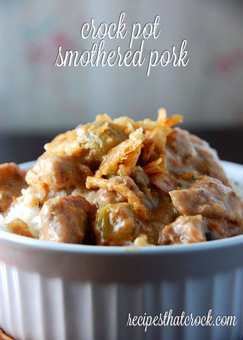 Crock Pot Smothered Pork - Delicious pork chops and gravy recipe for the slow cooker. Comfort food at its best!