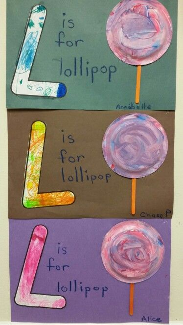 L is for lollipop. Great alphabet preschool craft.  The children colored the letter L with markers. Then I put small amounts of different color paint on the back of the paper plate. I put an cotton ball in a clothes pins and they swirled it around. Glued on a popcicle stick and voila`. From the Firefly class.