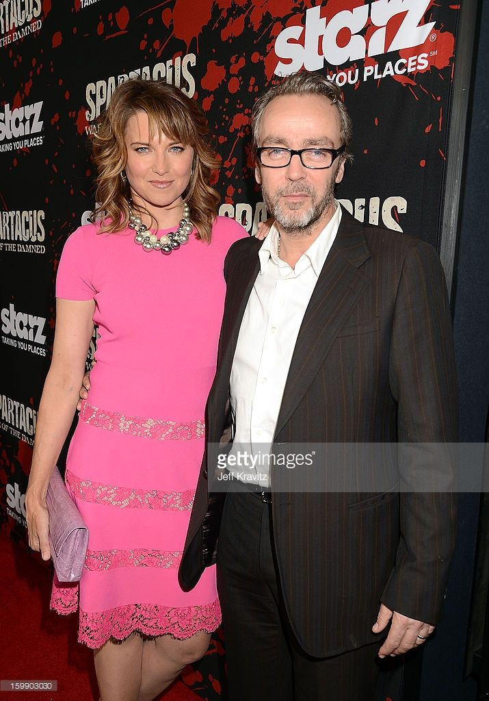 Actors Lucy Lawless (L) and John Hannah attend the 'Spartacus: War Of The Damned' premiere at Regal Cinemas L.A. LIVE Stadium 14 on January 22, 2013 in Los Angeles, California.