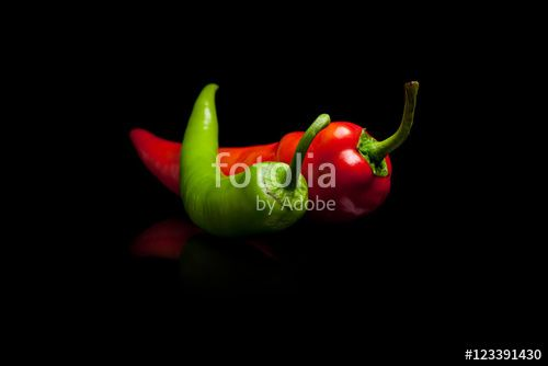 Red and green pepper black background