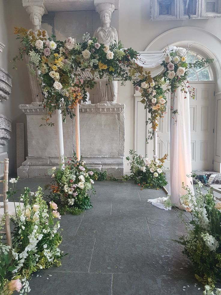 Chuppah and English Meadow Florals by Petalon