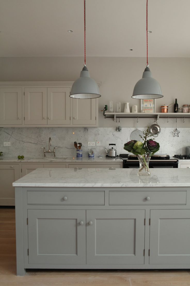 A total control AGA is the centre piece of this kitchen complimented by a substantial island topped with Carrara marble.