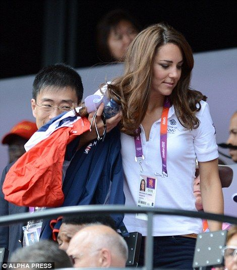 Kate went for a casual look today in the same white Team GB polo as yesterday with navy jeans and a thin brown belt, she carried a Team GB jacket with her