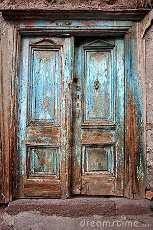 Antique old destroyed blue door