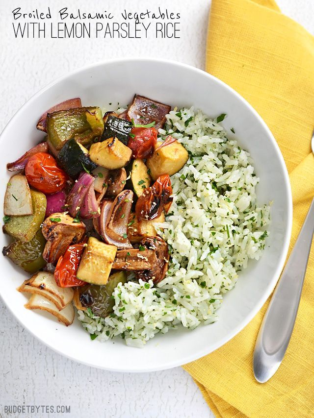Broiled balsamic vegetables top a vibrant and fresh lemon parsley rice to make this light and healthy dish. Works great as a side or a light meal.