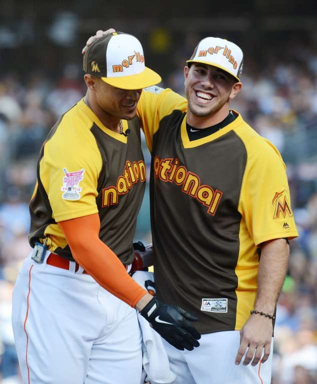 Giancarlo Stanton is greeted by Marlins teammate Jose Fernandez after his performance in the first r... - Jake Roth, USA TODAY Sports - 2016 MLB Home Run Derby - July 12, 2016